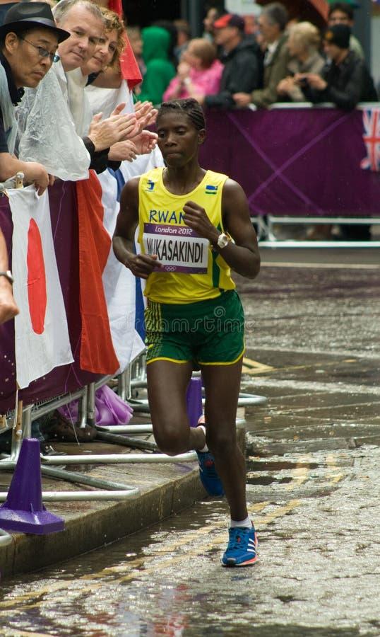 Free Claudette Mukasakindi Running The Olympic Marathon Stock Photo - 26100420