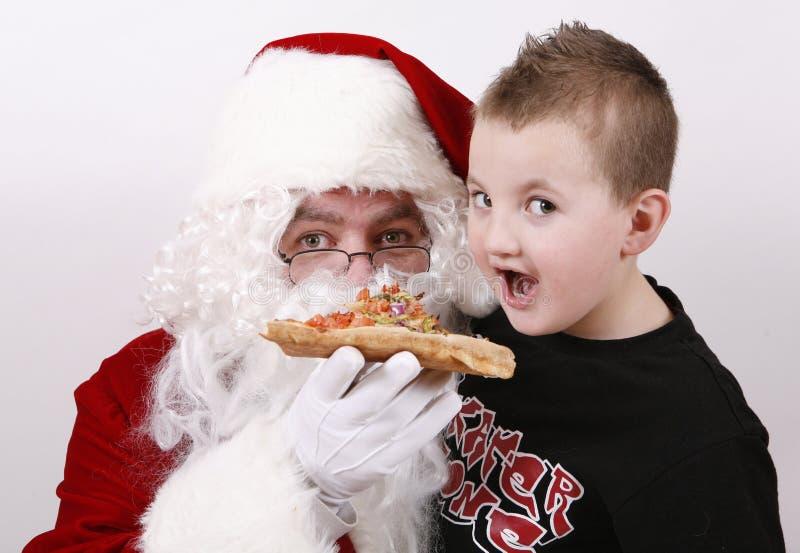 Claus που τρώει το χαμόγελο santa &p στοκ εικόνες με δικαίωμα ελεύθερης χρήσης