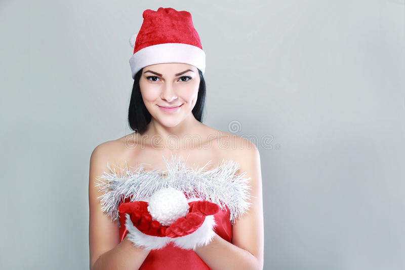claus одевает женщину santa стоковое фото