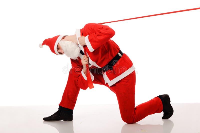 claus ciągnienie czerwony tasiemkowy Santa obrazy stock
