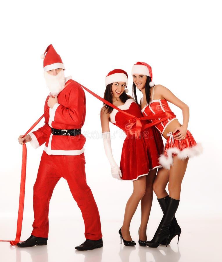 claus dziewczyn ciągnienie Santa dwa zdjęcia royalty free