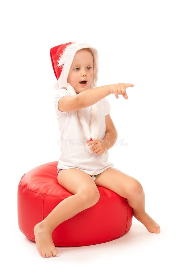 claus dziewczyny kapeluszowy mały Santa obsiadanie zdjęcia stock
