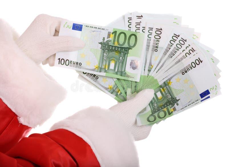 claus handpengar santa arkivbild