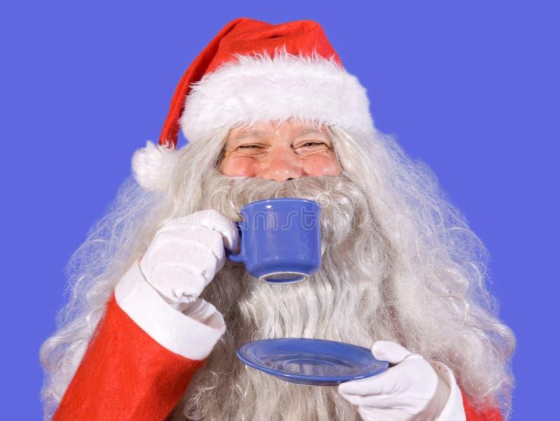 claus holdingsanta teacup royaltyfri fotografi