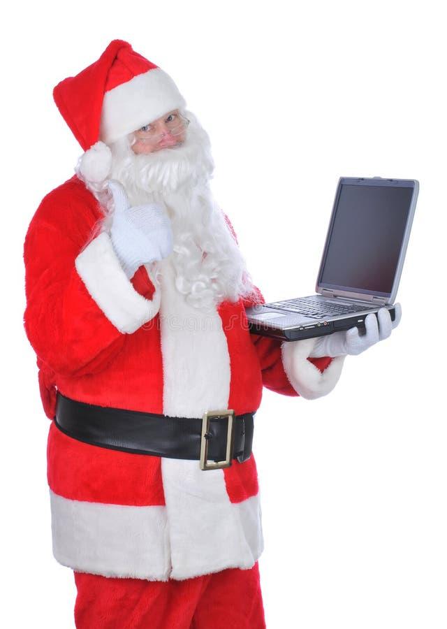claus mienia laptopu Santa aprobaty obraz stock