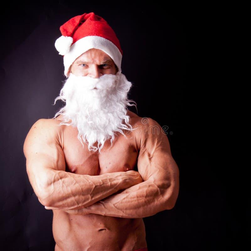 claus muskulösa santa arkivfoto
