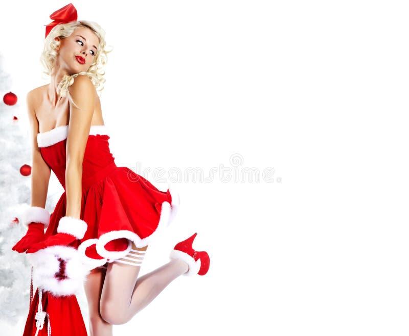 claus odzieżowa dziewczyny szpilka Santa odzieżowy target440_0_ fotografia royalty free