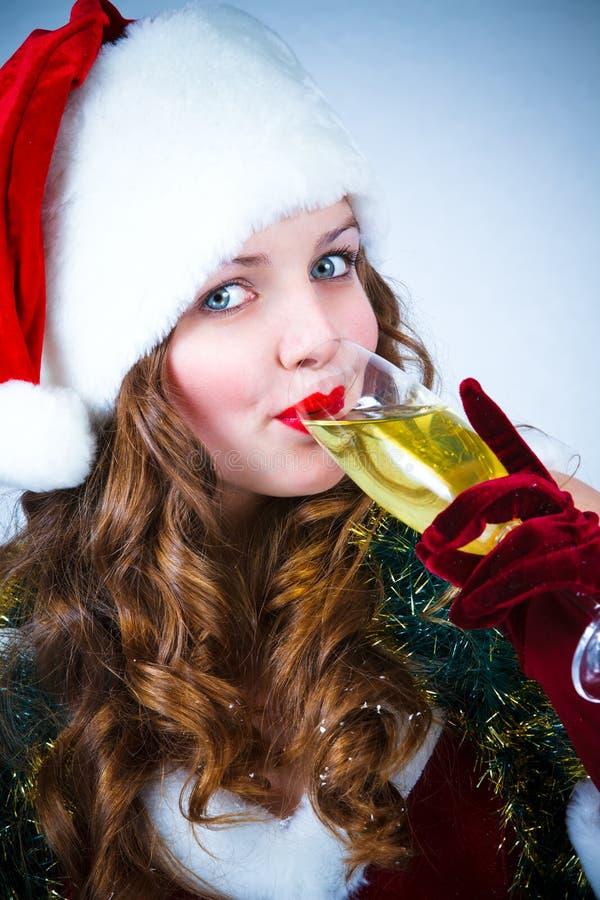claus szampańska dziewczyna szczęśliwy kapeluszowy Santa fotografia stock
