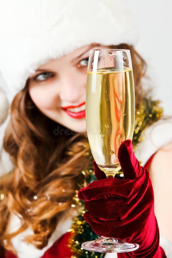 claus szampańska dziewczyna szczęśliwy kapeluszowy Santa obraz stock