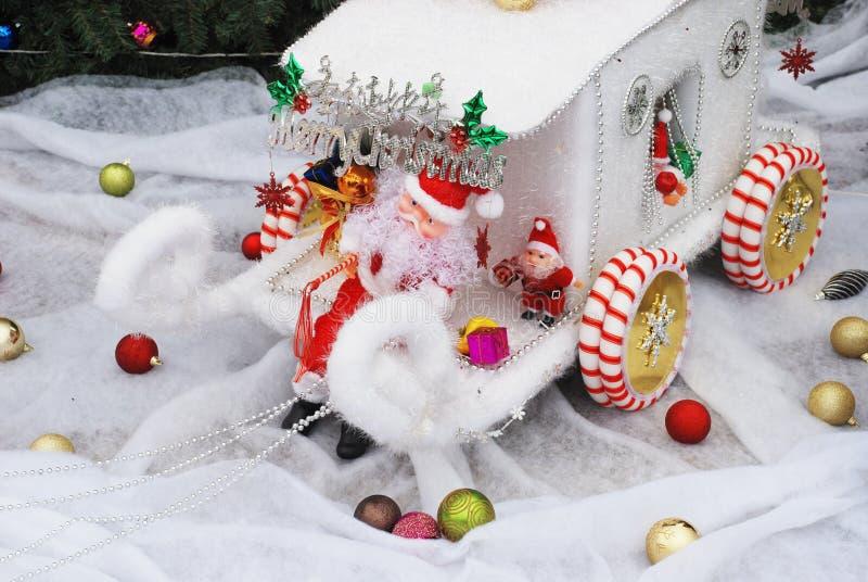 Clausola di Santan sul carrello della renna immagini stock libere da diritti