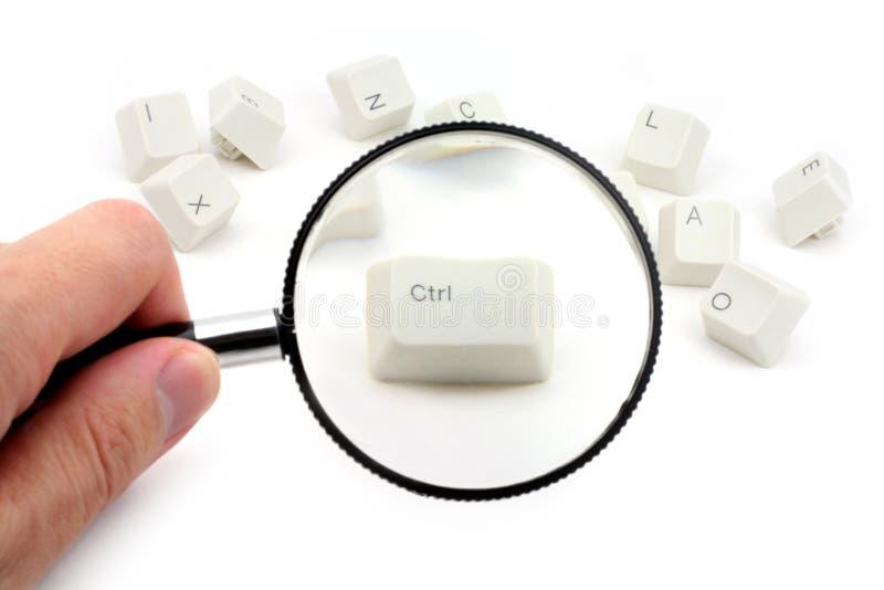 Clave de control y lupa foto de archivo libre de regalías