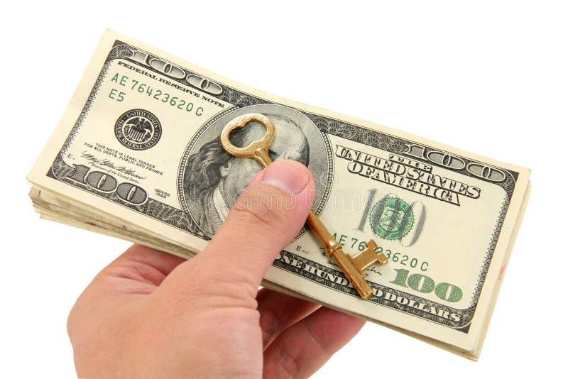 Clave y dólares del oro fotografía de archivo