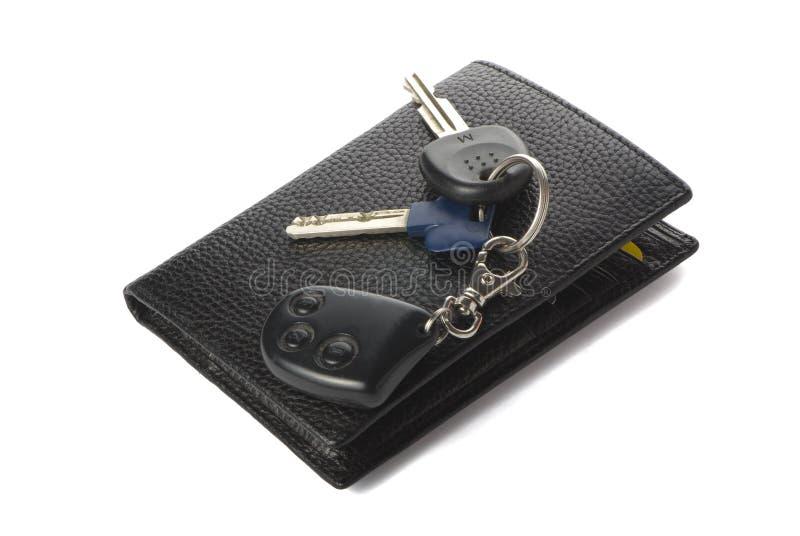 Claves de la carpeta y del coche imágenes de archivo libres de regalías
