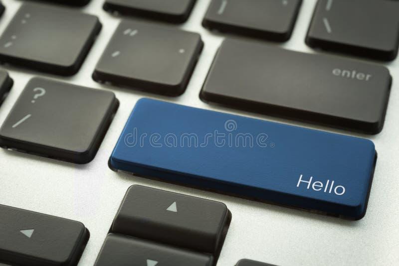 Clavier d'ordinateur avec le bouton typographique de BONJOUR photo libre de droits