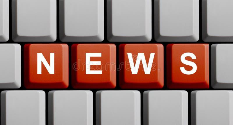 Clavier d'ordinateur rouge montrant des actualités photos libres de droits