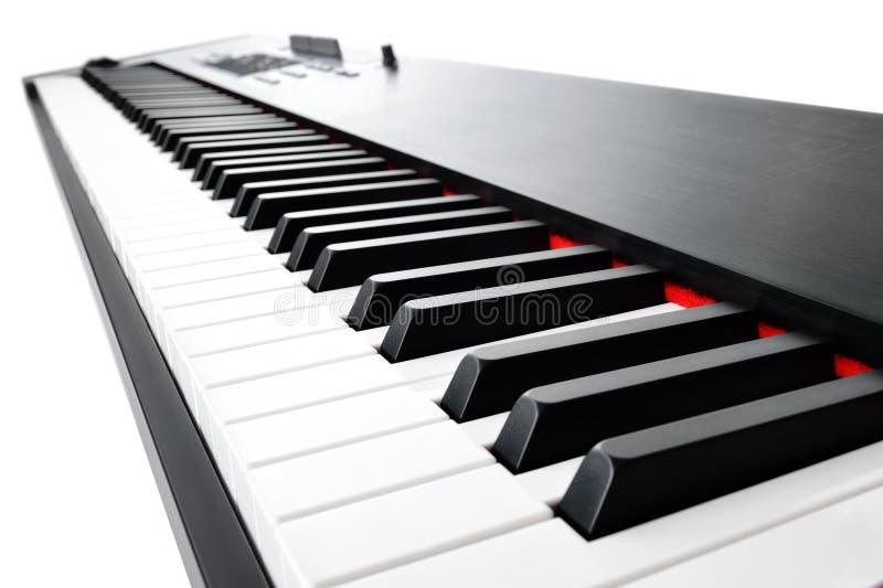 Clavier musical sur le blanc photos stock