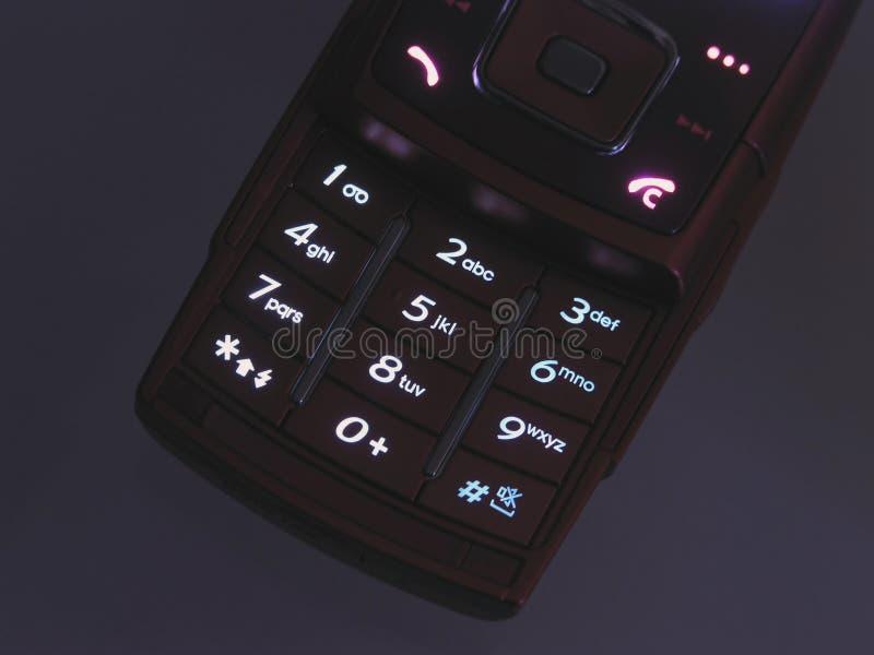 Clavier numérique lumineux de téléphone portable photographie stock libre de droits