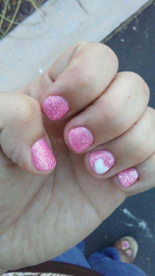 Clavos manicured rosados fotos de archivo