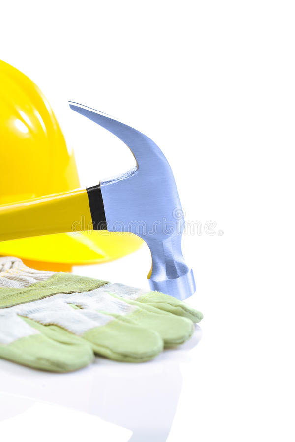 Claw hammer and glove hardhat royalty free stock images