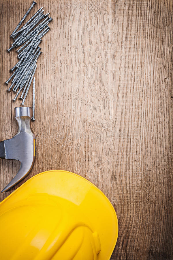 Claw hammer metal construction nails building helmet on wooden b. Oard stock images