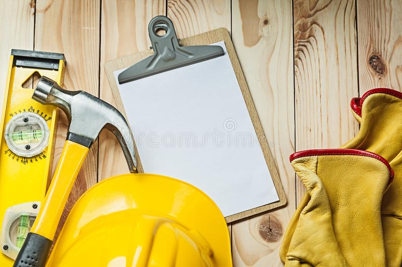 Claw hammer with wooden handle isolated on white stock image