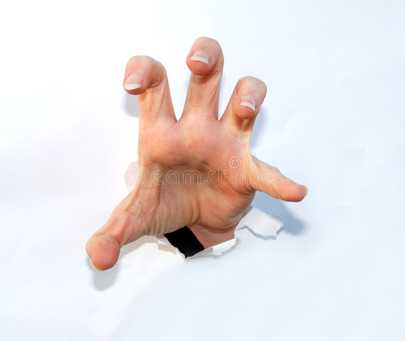 Claw hand. A human hand making a claw figure coming out of paper stock photos