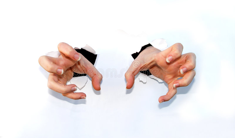 Claw hands. A pair of human hands making a claw figure coming out of paper royalty free stock images