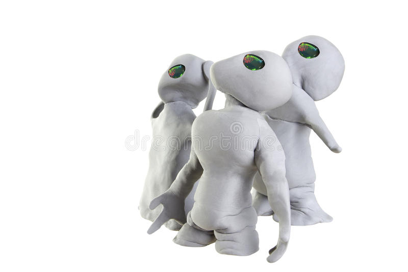 Clay Aliens. Gray alien made of clay on a white background stock photos