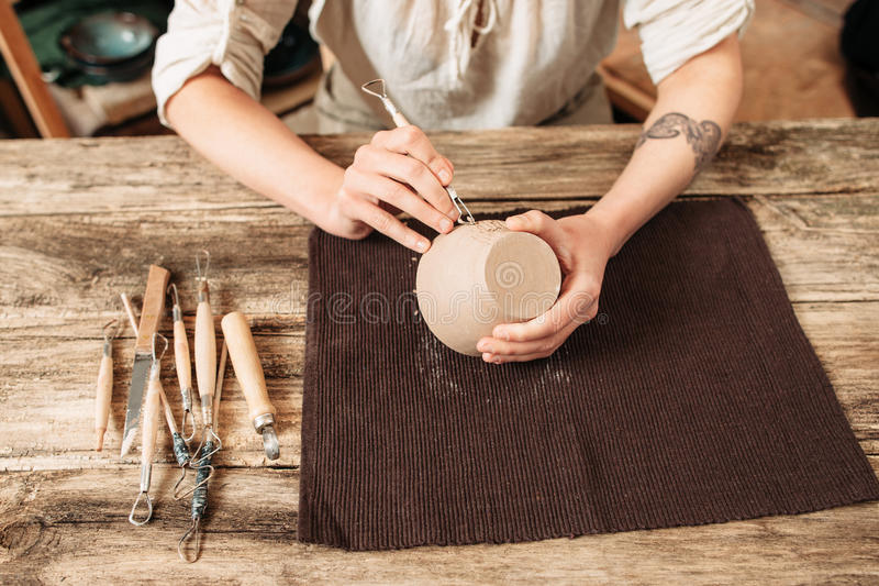 Clay bowl author decorating, pottery making royalty free stock photos