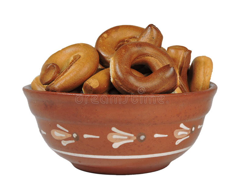 Clay bowl, a plate, a bowl, bagels, pretzels, isolate, white background stock photography