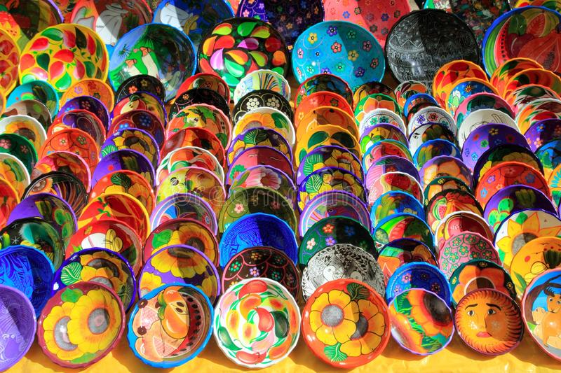 Clay ceramic plates from Mexico colorful. Traditional handcraft stock photography