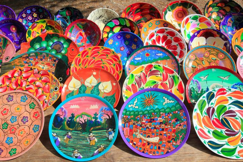 Clay ceramic plates from Mexico colorful. Traditional handcraft royalty free stock images