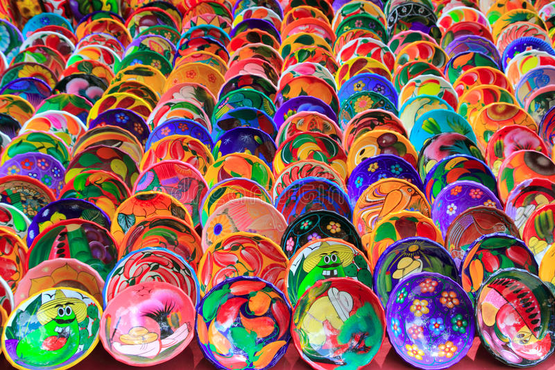 Clay ceramic plates from Mexico colorful. Clay ceramic colorful plates from Mexico traditional handcrafts stock image