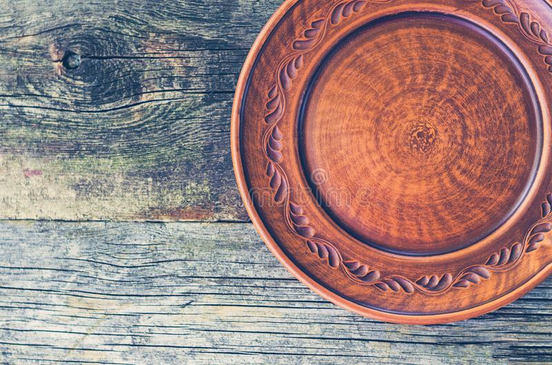 Clay dish on a wooden table.  royalty free stock photo