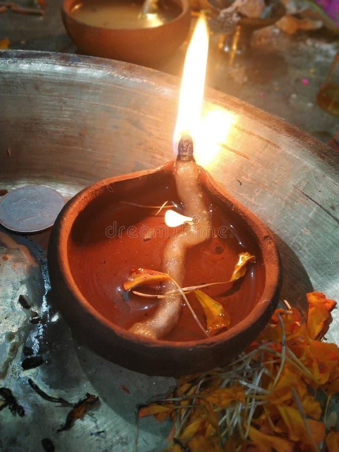 Clay Diya lit during diwali festival. Focus on Traditional Diya during Diwali festival stock images