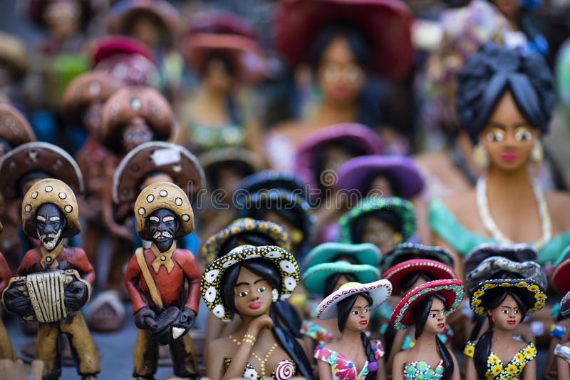 Clay dolls from Brazil. Concept of musicians and women. royalty free stock image
