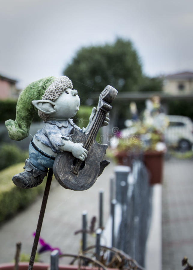 A clay elf play guitar stock images
