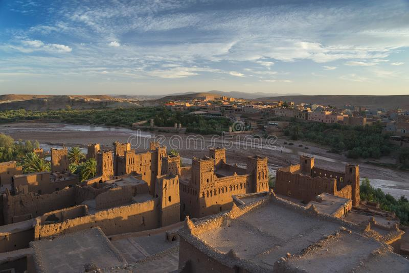 Clay fortress Ait Ben Haddou - view from above. Sunlit clay fortress Ait Ben Haddou - view from above. Beautiful sky in background royalty free stock photo