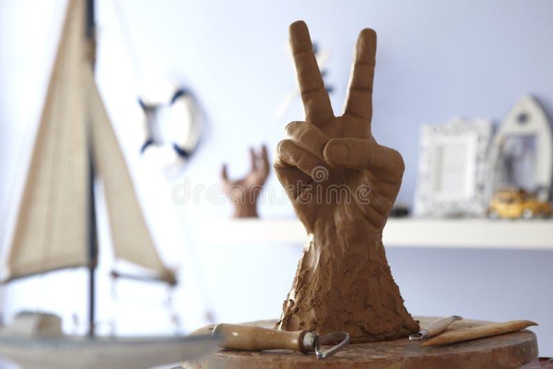 Clay Hand Statue immagini stock libere da diritti