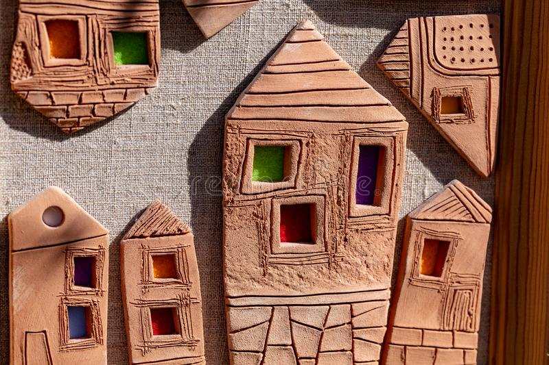 Clay houses, handmade. sculpture bas-relief. brown texture. Clay houses, handmade. sculpture bas-relief brown stock image