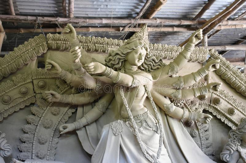 Clay idols of Durga under preparation before festival,Artist is busy to create clay idol royalty free stock photos
