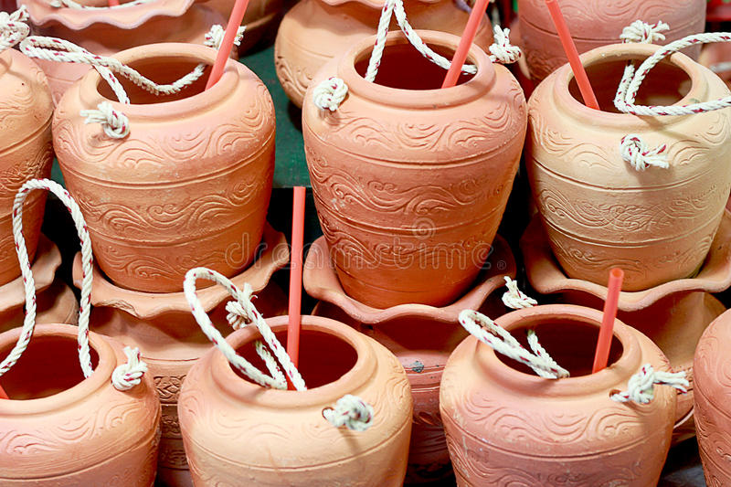 Clay jug with drinkingstraw. stock images