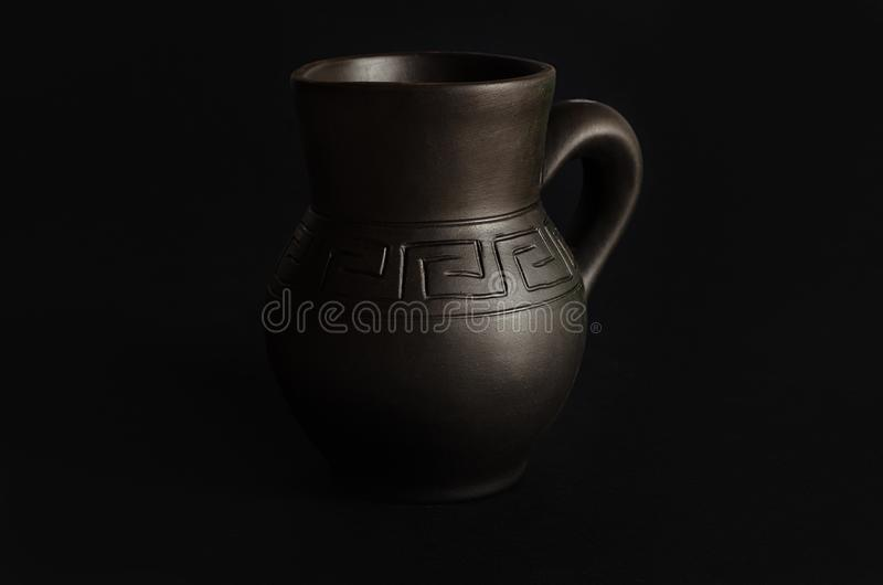 Clay jug, old ceramic vase on black background.  stock photography