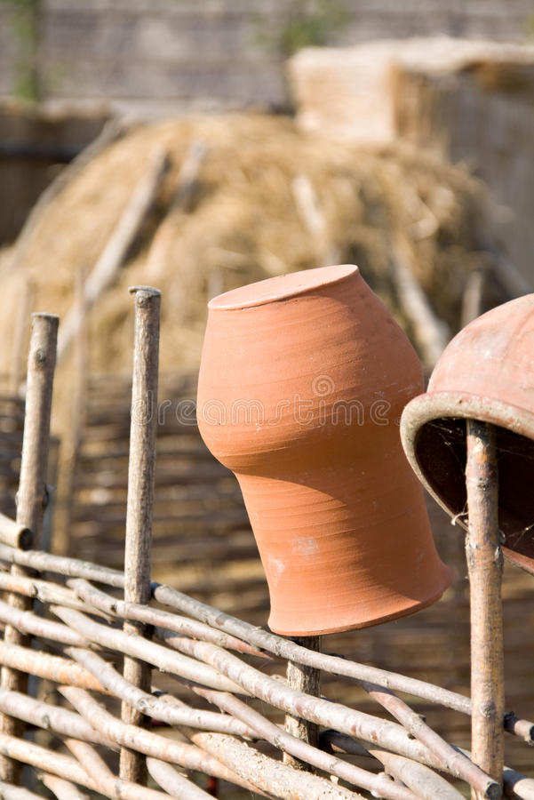 Clay Jugs On Fence Royalty Free Stock Image