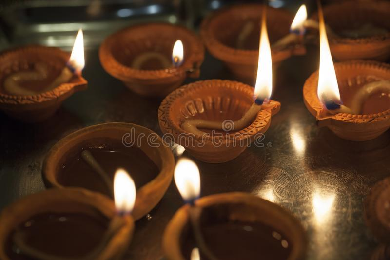 Clay lamp burning for Diwali stock photography
