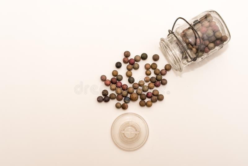Clay marbles spilt out of glass stock image