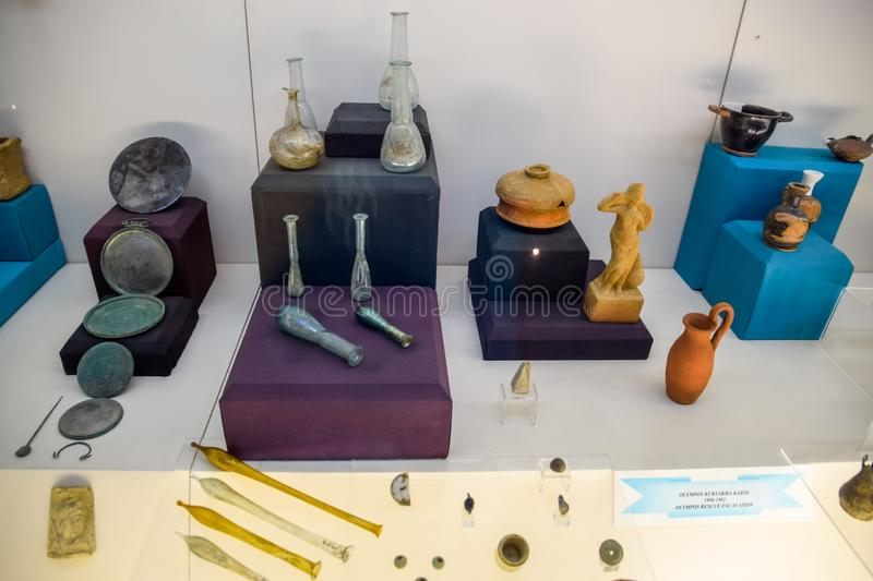 Clay and metal dishes and clay figurines and figurines in the museum of antiquity of Antalya. Antalya, Turkey - May 20, 2019: Clay and metal dishes and clay royalty free stock image