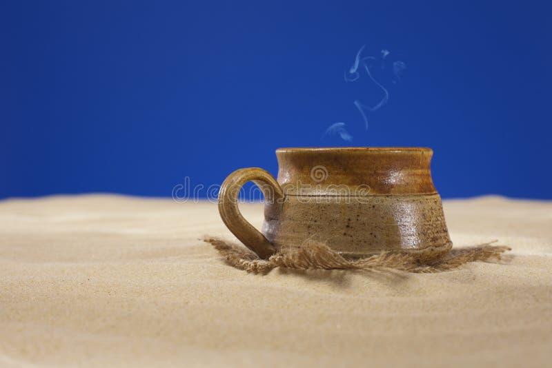 Download Clay Mug With Tea Or Coffee On Beach Sand Stock Image - Image: 17334909
