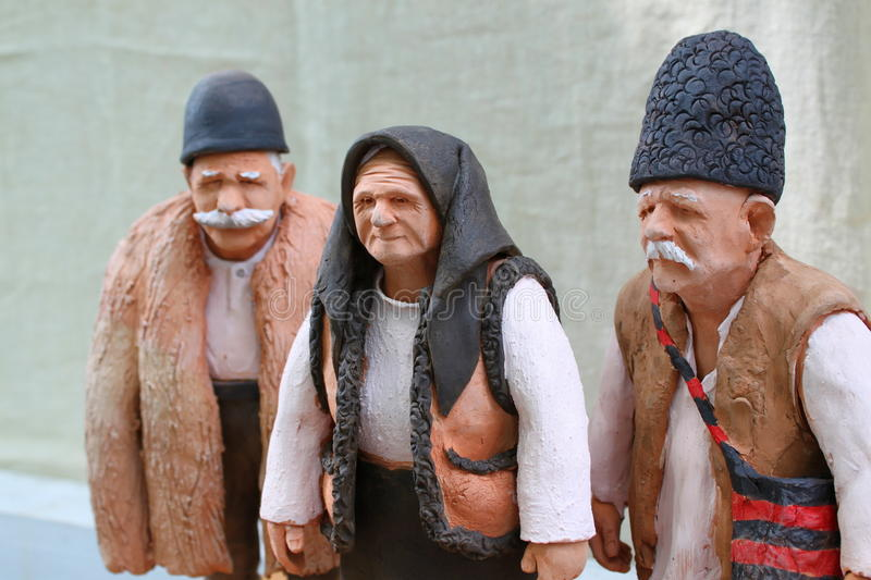 Clay old figures. Clay figures in traditional romanian peasant costumes stock image