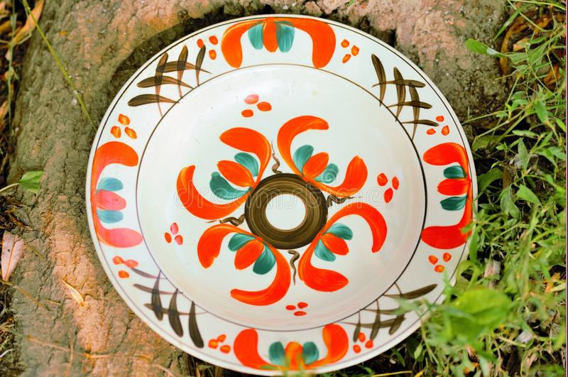 Clay painted plates. Unique and handmade clay painted plates, 50 years old, from creative people stock photo
